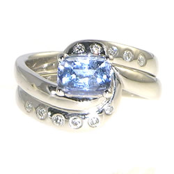 swirling water inspired fitted sapphire and diamond engagement and wedding ring set