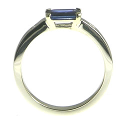 white gold deep blue sapphire emerald cut ring with side diamonds
