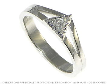 white gold mountain inspired engagement ring with triangular diamond
