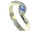 9ct white gold engagement ring with pear shaped blue sapphire and brilliant cut diamond