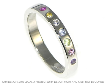 9ct white gold rainbow eternity ring with multi coloured gemstones