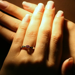 delicate 9ct white gold oval pink sapphire and diamond engagement ring