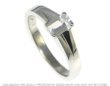 white topaz emerald cut solitaire engagement ring