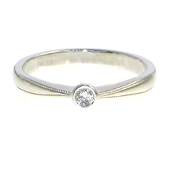 antique inspired white gold and diamond delicate engagement ring