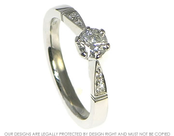 edwardian inspired 0.47cts central diamond platinum engagement ring with shoulder diamonds