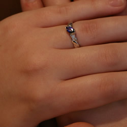 white gold celtic twist engagement ring with 0.62cts purple marquise sapphire