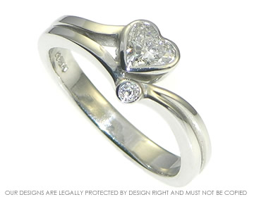 51def7248b0 Asymmetrical platinum engagement ring with 0.40cts HSI heart shaped ...