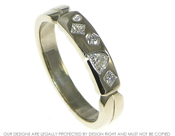 18ct white gold ring with unusual geometric scatter set diamonds