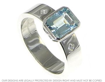ae8775d619bce 18ct White Gold emerald cut aquamarine engagement ring.