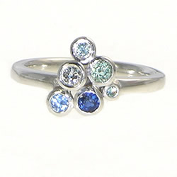 white gold, diamond, sapphire and tourmaline sea-foam inspired engagement ring