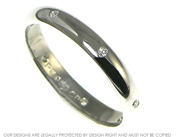 equally spaced diamond and palladium eternity ring