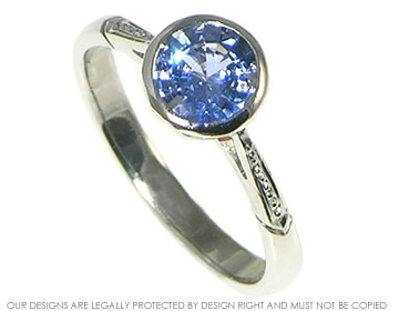 antique styled platinum engagement ring with cornflower blue sapphire