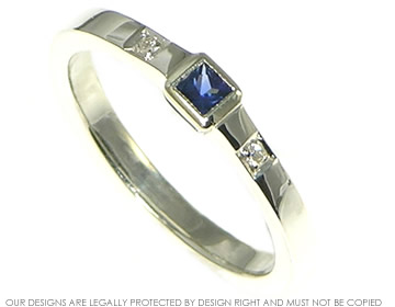 white gold delicate sapphire and diamond engagement ring