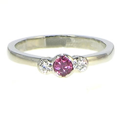 platinum oval/cushion cut ruby and diamond engagement ring