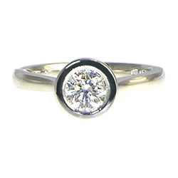 platinum 0.72ct e si1 diamond solitaire engagement ring with open tip design