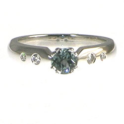 18ct white gold engagement ring with green sapphire and diamonds