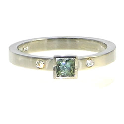 a palladium green sapphire and diamond engagement ring