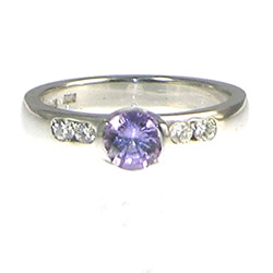9ct white gold and 0.59ct brilliant cut lilac sapphire and diamond engagement ring