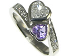 bespoke platinum engagement ring with a heart shaped diamond and amethyst