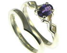 bespoke 9ct white gold engagement and wedding ring set with a deep purple sapphire