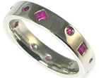 platinum and ruby scatter set eternity ring