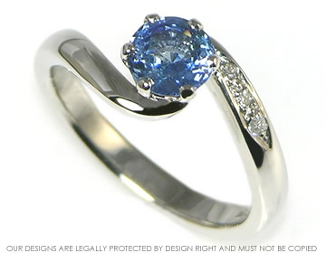 Platinum Blue Sapphire Twist Ring With Pave Set Shoulder