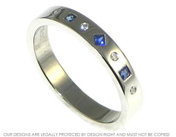 palladium eternity ring with sapphires and diamonds set at different angles