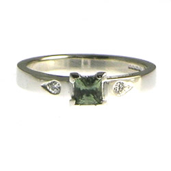 18ct white gold, 0.40ct natural african green sapphire and grain set diamond engagement ring
