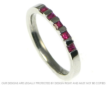 palladium eternity ring with five princess cut rubies