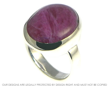 dramatic rounded 14.09cts ruby matrix ring