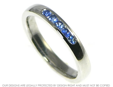 platinum blue sapphire eternity ring with a soft courting profile