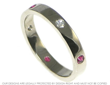 18ct white gold diamond and ruby eternity ring