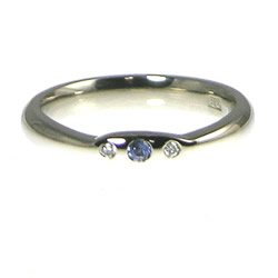 palladium engagement ring with invisibly set sapphire and diamonds