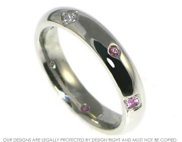 palladium, diamond and pink sapphire scatter set eternity ring