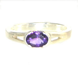 sterling silver engagement ring with a 0.74ct oval facetted amethyst in an end only setting