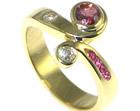 bespoke 18ct yellow gold twist eternity ring using customers own rubies and diamonds