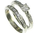 vintage styled platinum and diamond engagement and wedding ring set