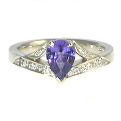 platinum and colour change purple sapphire engagement ring
