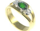 contemporary mixed metal engagement ring with deep green tsavorite and diamonds