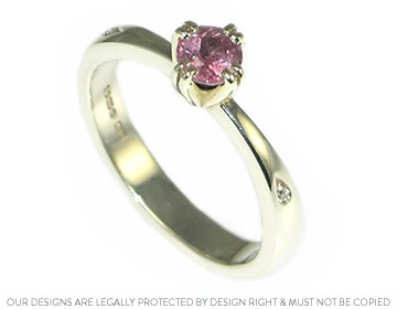 simple 9ct white gold engagement ring with pink sapphire and shoulder set diamonds