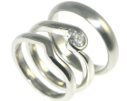 bespoke platinum wave inspired engagement and wedding ring set with brilliant cut 4mm .25ct gvs diamond