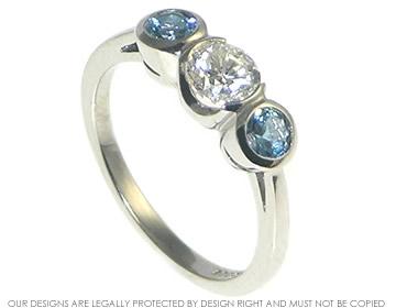 ee2290af3adb0 Palladium and recycled diamond and aquamarine three stone ring.