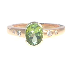 9ct rose and white gold engagement ring with green tourmaline