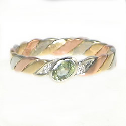 hand-plaited celtic twist band with green sapphire and diamonds