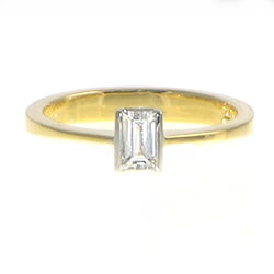 delicate mixed metal baguette cut diamond solitaire engagement ring