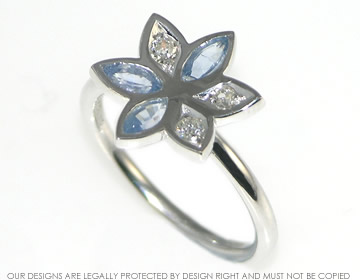 modern daisy cluster with marquise cut pale blue sapphires and recycled diamonds