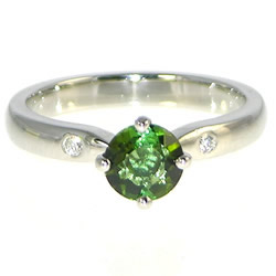 simple platinum, bright green tourmaline and diamond engagement ring