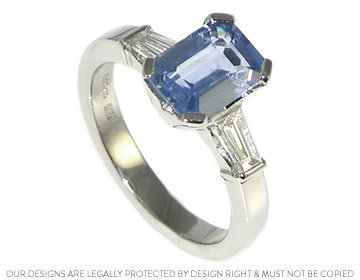Palladium Engagement Ring With An Emerald Cut Pale Blue
