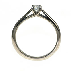 crossover setting diamond solitaire engagement ring in 18ct fairtrade gold