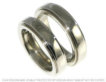 chunky and heavy 18ct white gold rings with stepped profiles